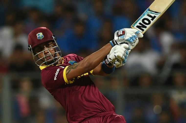 Lendl Simmons' 51-ball 82 helped West Indies beat India by seven wickets to set up final clash with England on Sunday. (Getty Images)