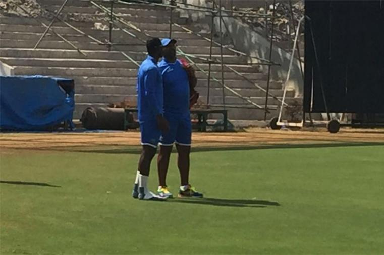 West Indies coach Phil Simmons in conversation with players during training session.