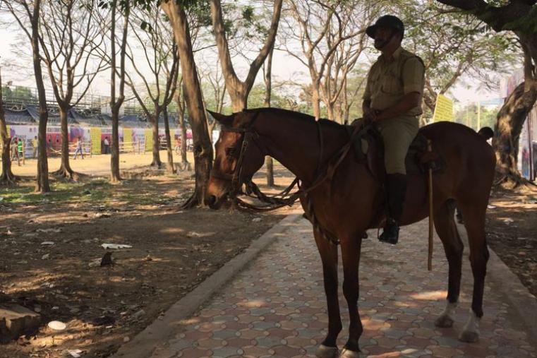Police officer was seen taking the rounds at the Eden Gardens. (CricketNext)