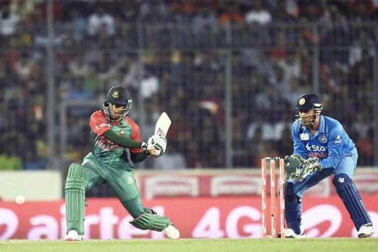 Shakib (21) was caught by Bumrah at short fine leg while trying to sweep Ashwin. (AFP Photo)