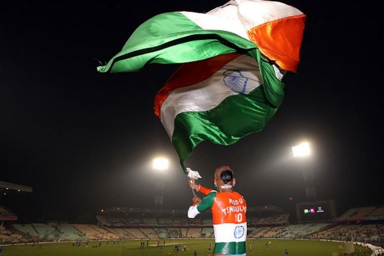 Famous Indian fan Sudhir waves Indian flag and shows his support to the team.