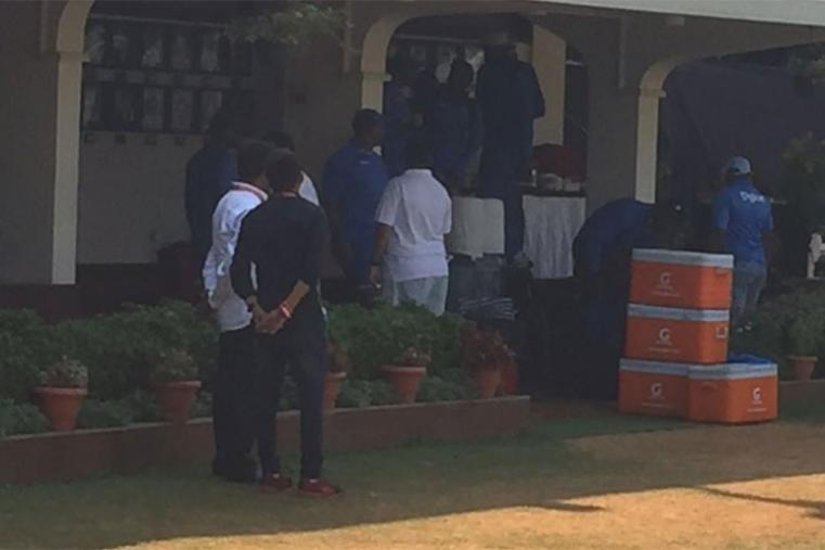 West Indies team take a snacks break after their training session.