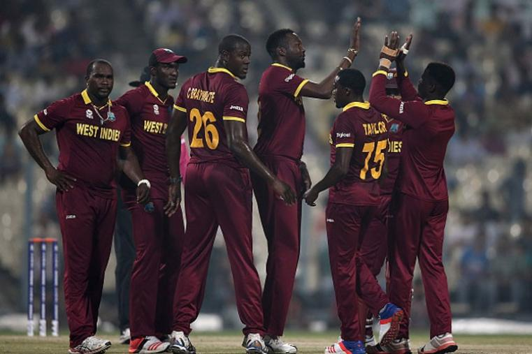 West Indies players celebrate after picking up the wicket of Shikhar Dhawan.