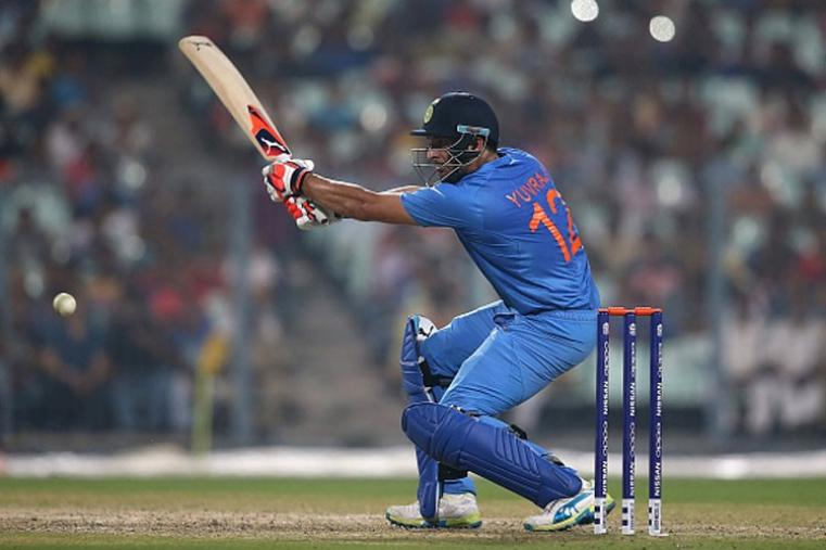 Yuvraj Singh hits Windies bowler for a boundary in his solid knock of 31.