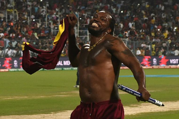 Chris Gayle took off his team jersey to celebrate their win at the Eden Gardens. (Getty Images)