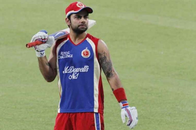 Royal Challengers Bangalore (Virat Kohli): Virat Kohli led Royal Challengers Bangalore in a few games in IPL 2012 beafore he became a full-time captain of the IPL team in 2013 season. Retained by the franchise ahead of the 2014 Player Auction, Virat continues to lead them. (Image: Getty Images)