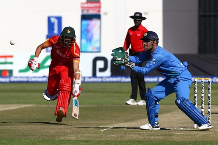 India skipper Dhoni fields as Zimbabwe captain Graeme Cremer runs between the wickets. (Photo Credit: Getty Images)