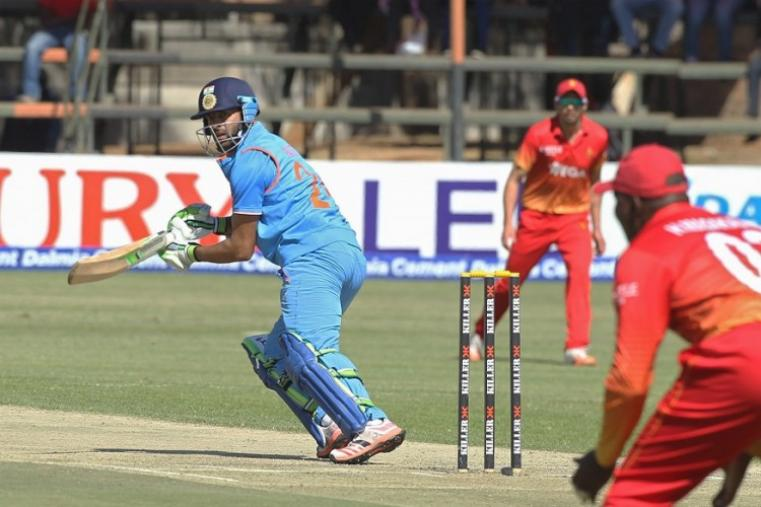 After a four-for from Jasprit Bumrah helped the visitors bowl out the hosts for a meagre 123 in 42.2 overs, Indian openers KL Rahul (63*) and debutant Faiz Fazal (55*) had an outstanding show with the bat and their unbeaten 126-run stand took their team to another comfortable victory in just 21.5 overs. (AP Photo)