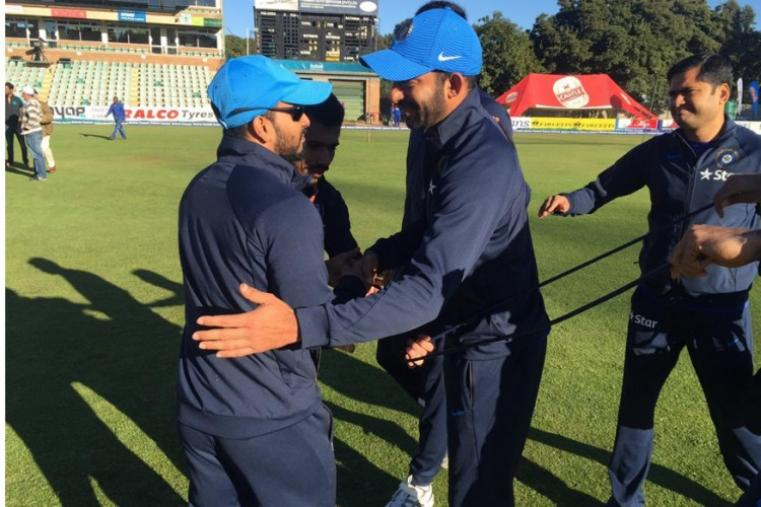 Faiz Fazal, who made his India debut, being congratulated by his teammates. (BCCI)