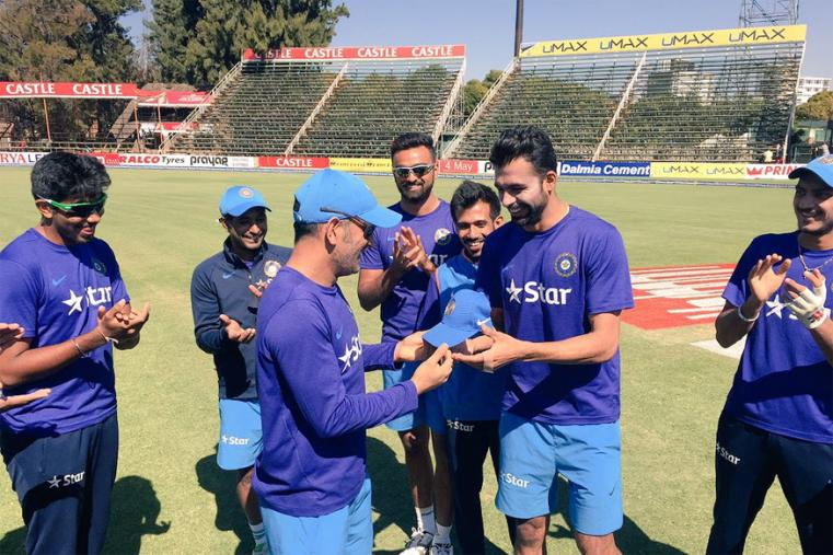 Barinder Sran receives the T20I debut cap from Skipper MS Dhoni. (Photo Credit: Getty Images)