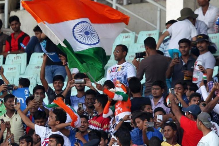 Indian fans cheer the team during the day one of the first Test. (BCCI Image)