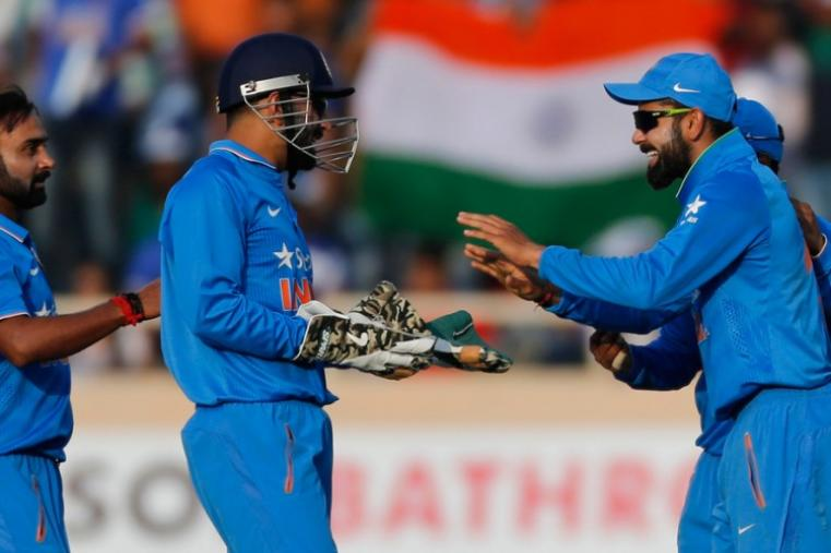 Virat Kohli, Amit Mishra and MS Dhoni celebrating after dismissing James Neesham. (AP)