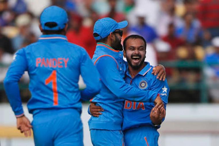 Kedhar Jadhav celebrating his second wicket of Mitchell Santner with skipper Virat Kohli at Dharmshala's HPCA. (Picture Credit: Getty Images)