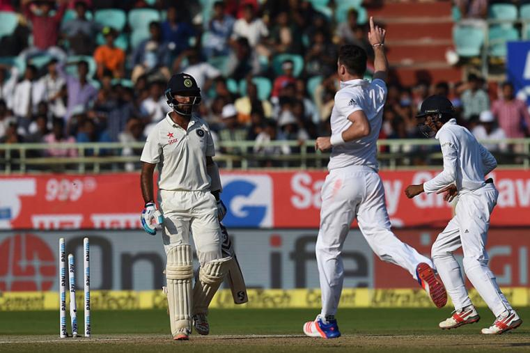 England pacer James Anderson celebrates after dismissing Cheteshwar Pujara during the third day of the Vizag Test. (AFP Images)
