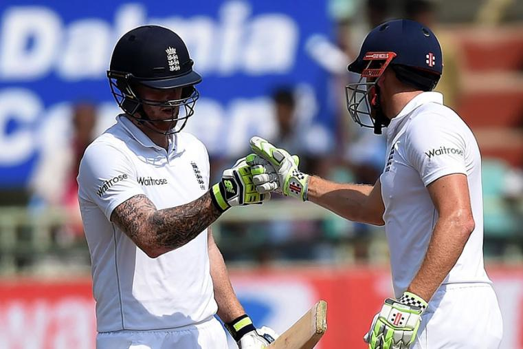 England batsmen Jonny Bairstow and Ben Stokes celebrate after scoring their respective half centuries on the third day of the Vizag Test. (AFP Images)