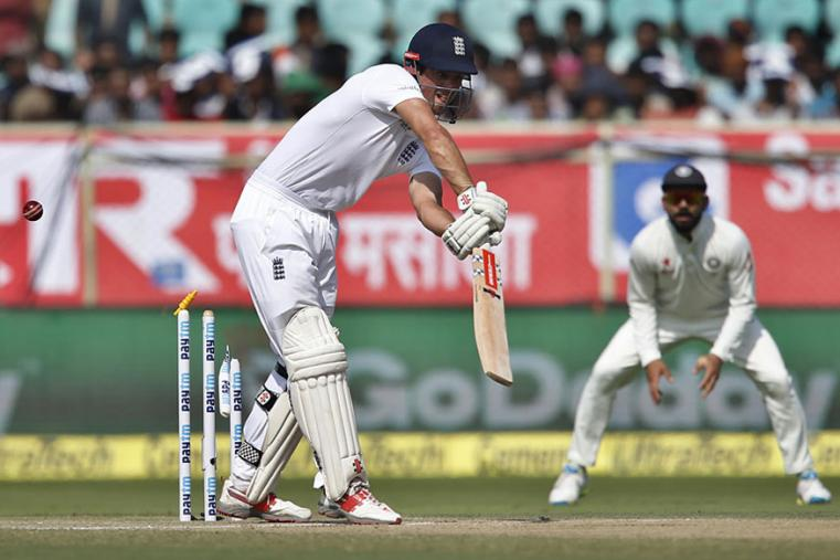 England Captain Alastair Cook is clean bowled by India's Mohammad Shami during the secon day of the Vizag Test. (AP Images)