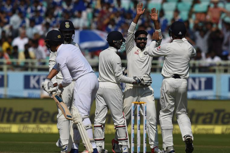 Ravindra Jadeja celebrates a wicket with the fellow teammates during the third day of the Vizag Test. (AFP Images)
