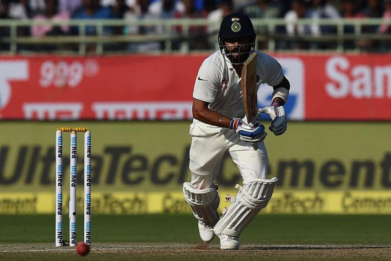 Indian Skipper Virat Kohli scored his 13th Test half century on the third day of the Vizag Test. (AFP Images)