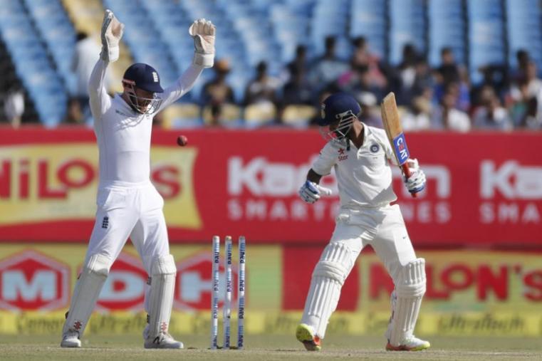 England's wicket-keeper Jonny Bairstow celebrates the wicket of Indian batsman Ajinkya Rahane on the fourth day of Rajkot Test. (AP Images)