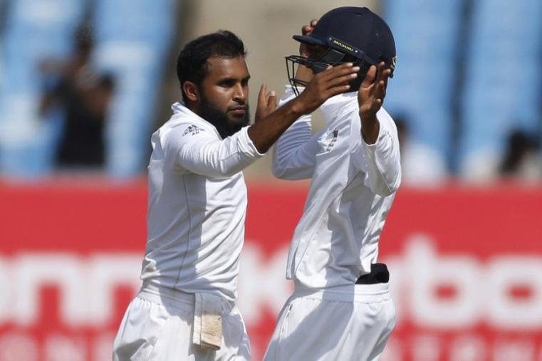 England's bolwer Adil Rashid, left, celebrates the wicket of Indian batsman Ravindra Jadeja with Haseeb Hameed on the fourth day of the Rajkot Test. (AP Images)