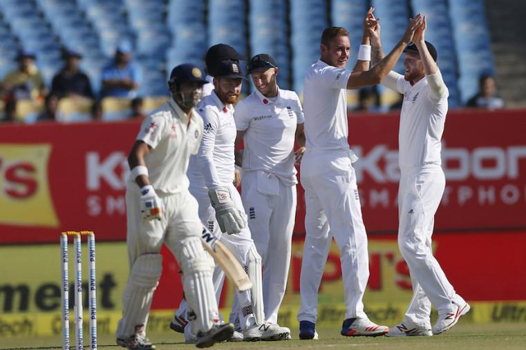 England's player celebrates the wicket of Indian batsman Gautam Gambhir left, during the third day of  the Rajkot Test. (AP Images)