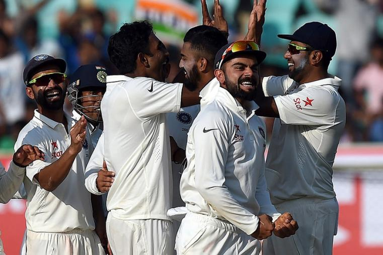 Indian team celebrates Jayat Yadav's first wicket in Test Cricket during the second day of the VIzag Test. (AFP Images)