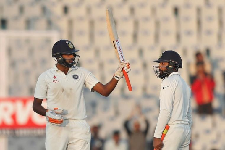 R Ashwin enhanced his new-found batting reputation with an unbeaten 57 while all-rounder Ravindra Jadeja was batting on 31 at stumps with India trailing by 12 runs. (AFP Photo)