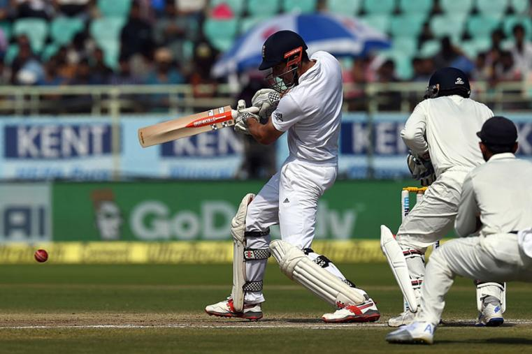 Alastair Cook cuts through the off side enroute his half century during the fourth day for the Vizag Test. (AFP Images)