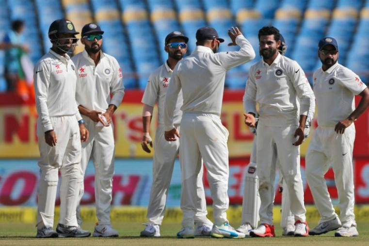 Ravindra Jadeja struck the first blow for India, trapping Alastair Cook lbw with a delivery that turned into the England skipper's pads after pitching. (AFP Photo)