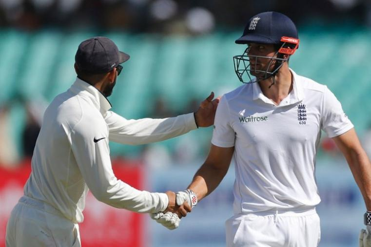 Alastair Cook is congratulated by Virat Kohli after getting to a century in Rajkot. (Image credit: AFP)