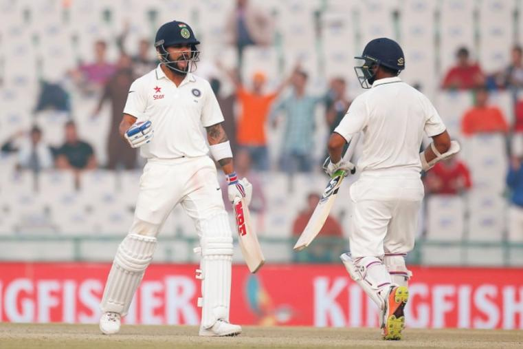 Captain Virat Kohli celebrates with Parthiv Patel after India won the third Test. India now lead the five-match series 2-0 with the fourth Test in Mumbai starting on December 8. (Reuters Photo)
