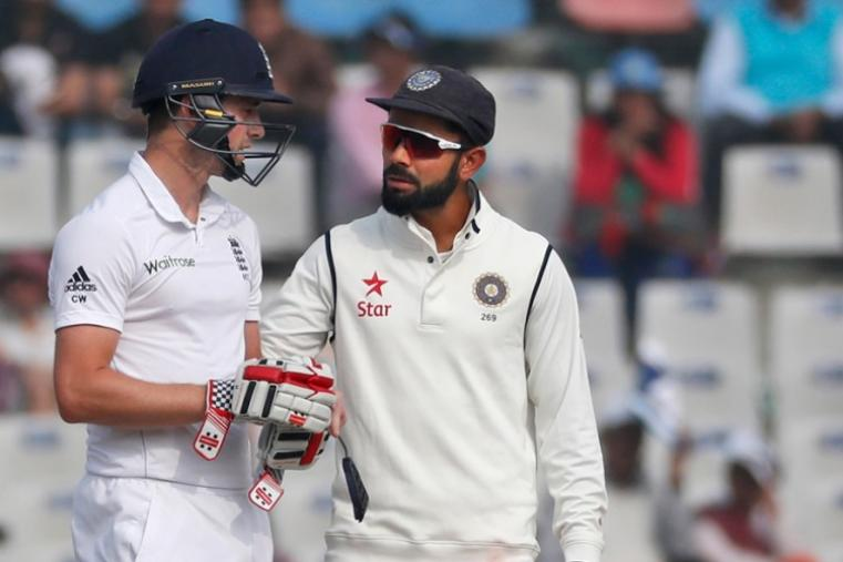 India captain Virat Kohli finds out about any possible injuries from England's Chris Woakes after he was hit by a bouncer from Mohammed Shami. (AP Photo)