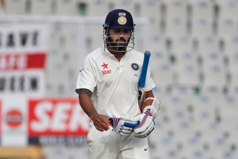 Murali Vijay walks back to the pavilion after being dismissed for a duck by Chris Woakes. (AP Photo)