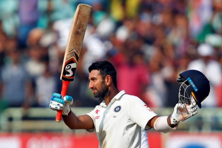 Cheteshwar Pujara notched up his 10th Test century. He smashed 12 boundaries and 2 sixes in his 119-run innings. (Image credit: Reuters)