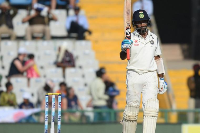 Cheteshwar Pujara posted a patient 51 off 104 balls before being sent back by leg-spinner Adil Rashid. (AFP Photo)