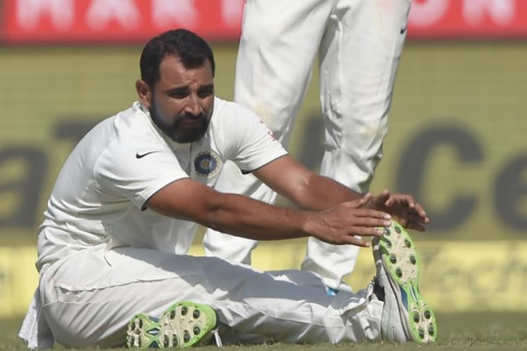 Indian pacer Mohammed Shami stretches after pulling his hamstring. (AFP Photo)