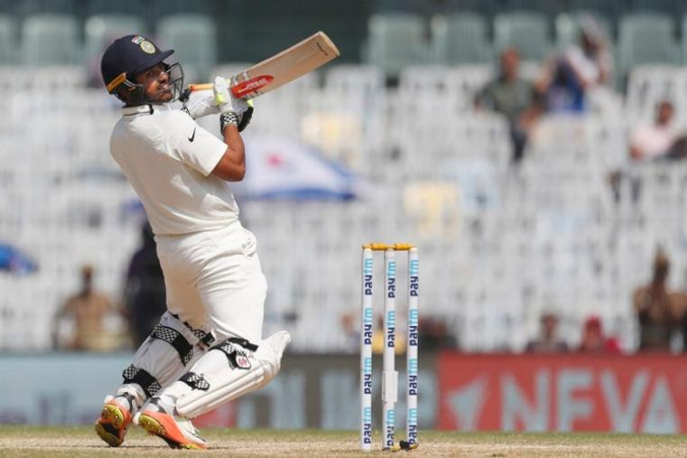 Playing only his third Test, the 25-year-old Nair forged two major partnerships -- 181 for the sixth wicket with Ravichandran Ashwin (67) and then 138 for the seventh wicket with Ravindra Jadeja (51) -- to take India to the record total at the M.A. Chidambaram Stadium. (AFP Photo)