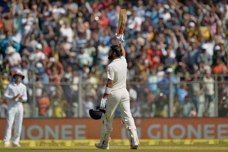 Virat Kohli celebrates his third double ton of the year during during the fourth day of the fourth Test between India and England at the Wankhede. (AFP Images)