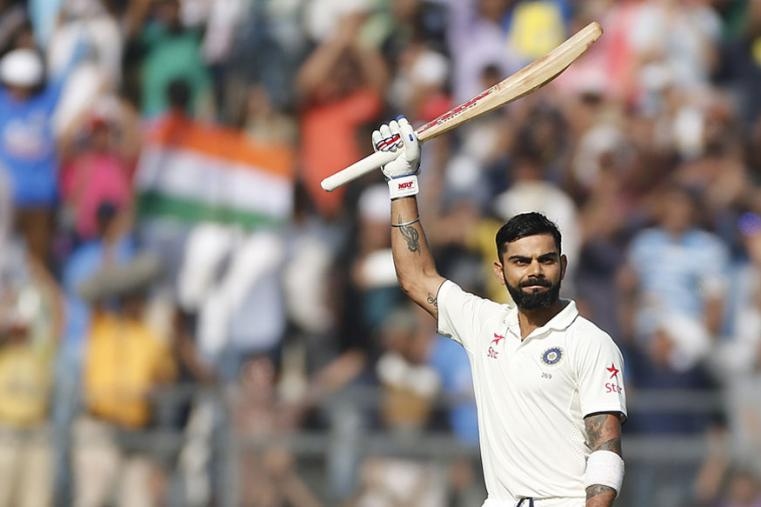 Indian Captain Virat Kohli celebrates his 15th Test Century during the third day of the fourth Test between India and England at Wankhede. (AFP Images)