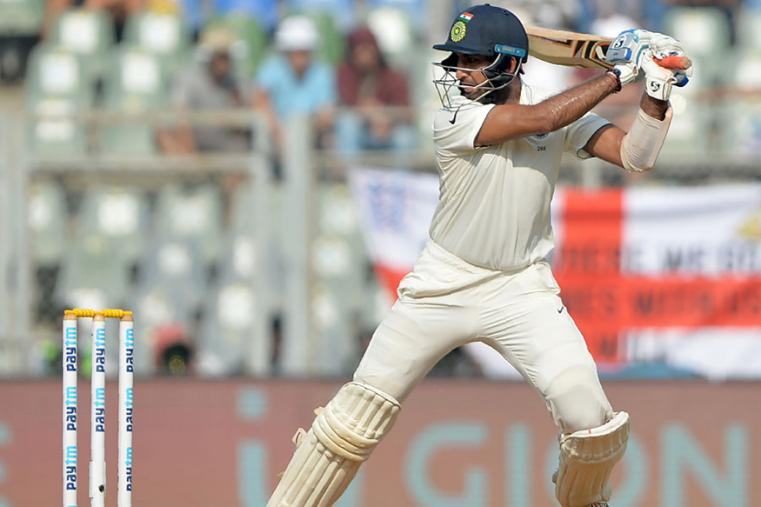Cheteshwar Pujara helped form a solid second-wicket stand during the fourth Test between India and England in Mumbai. (AFP Images)