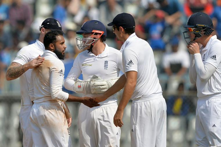 Adil Rashid broke the century stand when he removed M Vijay during the third day of the fourth Test between India and England at Wankhede. (AFP Images)