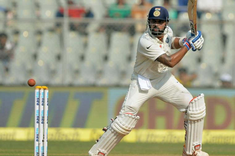 M Vijay slaps one through point during the fourth Test between India and England in Mumbai. (AFP Images)