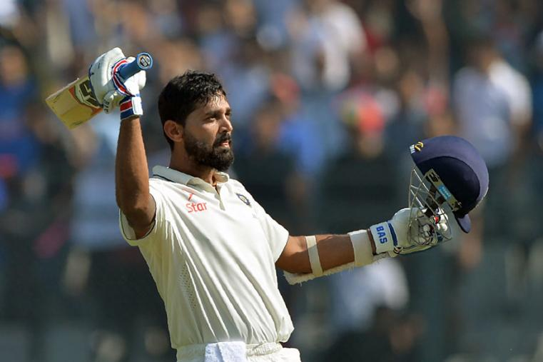 Murali Vijay celebrates his 8th Test century during the third day of the fourth Test between India and England at Wankhede. (AFP Images)