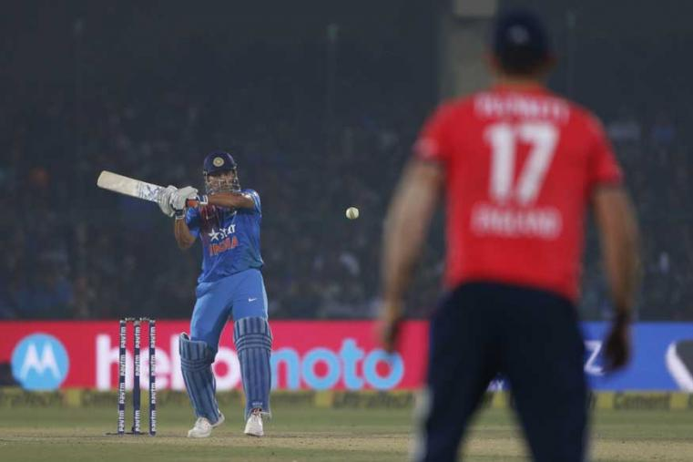 MS Dhoni plays a shot during their first Twenty20 cricket match against England in Kanpur. (AP Photo)