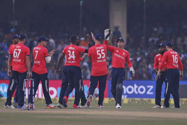 England team members celebrate the dismissal of India's KL Rahul during their first Twenty20 cricket match against India. (AP Photo)