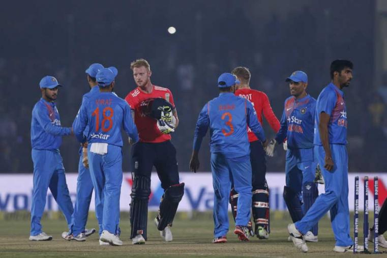 England's Ben Stokes shakes hand with India's captain Virat Kohli and other players after beating India. (AP Photo)