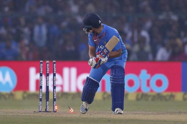 India's Suresh Raina is bowled by England's Ben Stokes during their first Twenty20 match in Kanpur. (AP Photo)