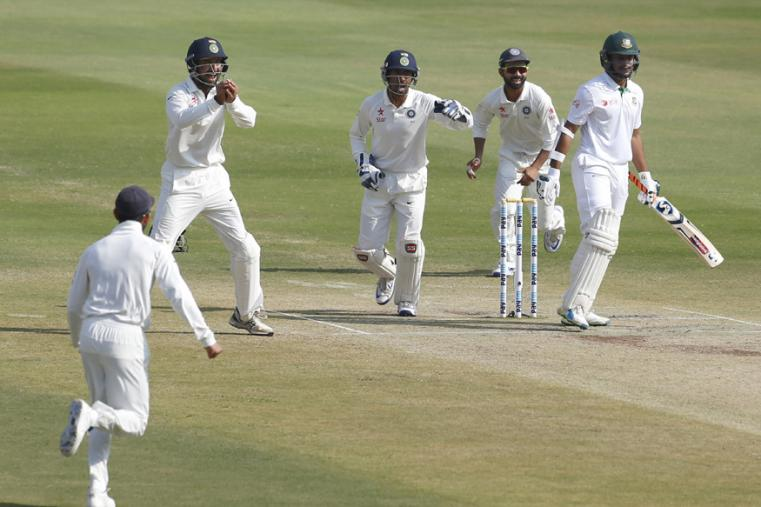 India's Cheteshwar Pujara, second from left, and teammates celebrate the dismissal of Bangladesh's Shakib Al Hasan, right, during the last day of their one-off cricket test match in Hyderabad. (AP Photo)