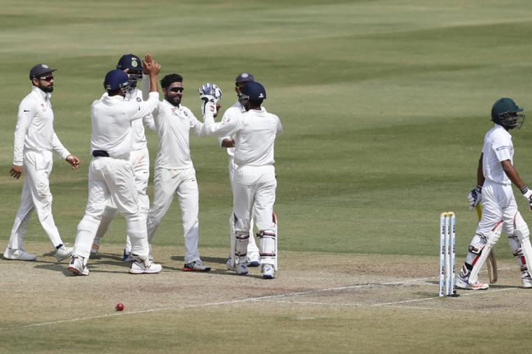 India's Ravindra Jadeja, center without a cap, celebrates with teammates the dismissal of Bangladesh's Mehedi Hasan, right, during the last day of their one-off cricket test match in Hyderabad. (AP Photo)