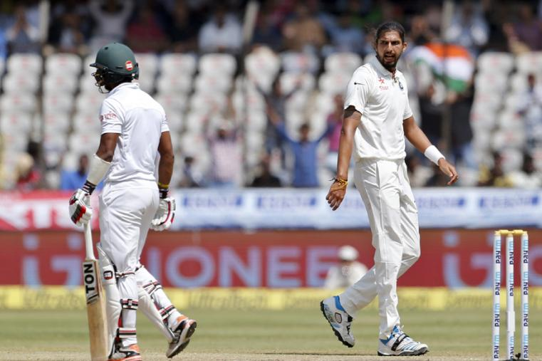 Ishant Sharma, right, gestures towards Bangladesh's Sabbir Rahman, left, after taking his wicket during the last day of their one-off cricket test match in Hyderabad. (AP Photo)